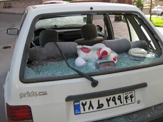 A resident's car after the Basij attacked it
