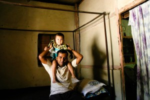 Rashed with a baby in a Khashia home