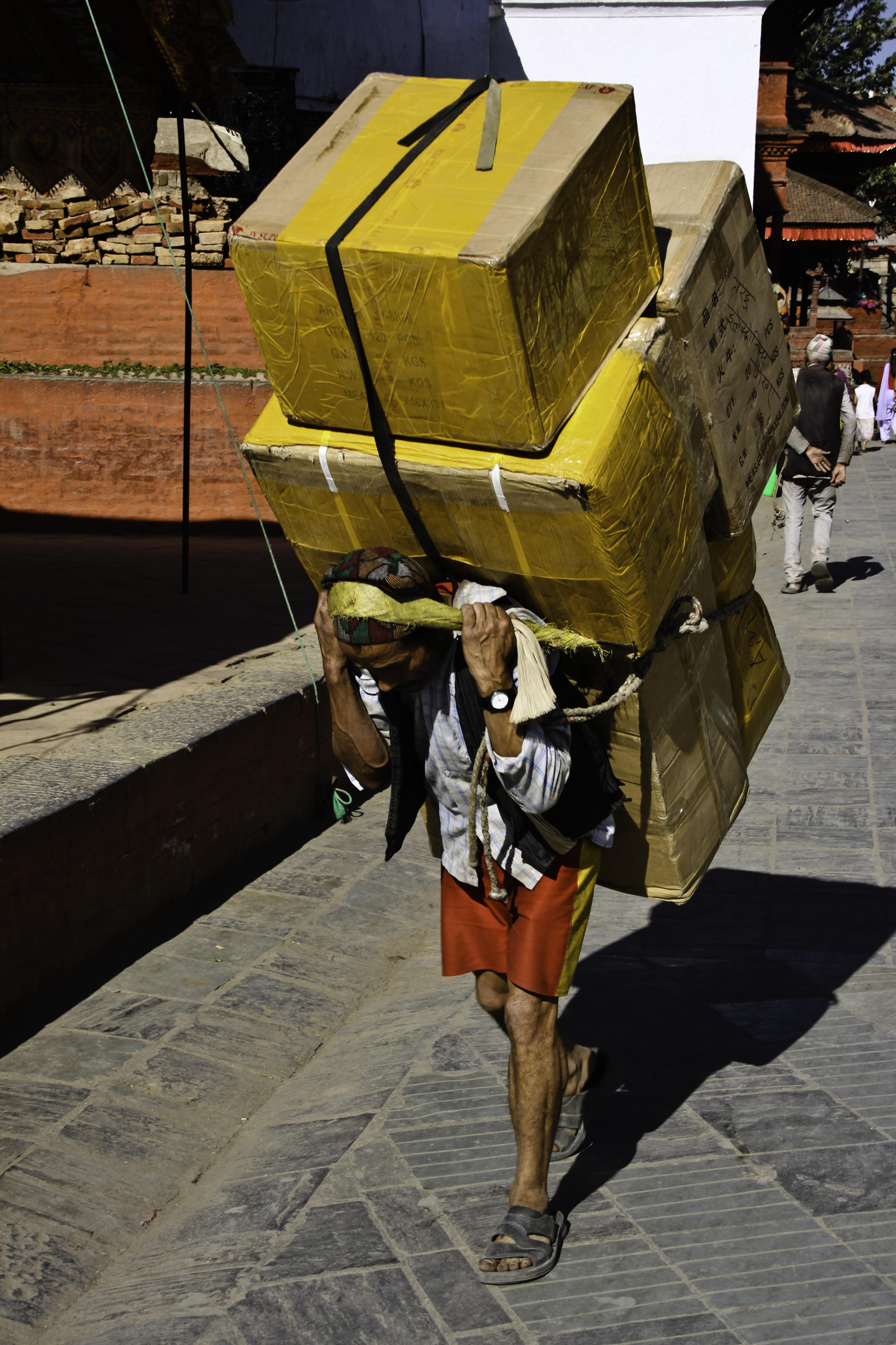 carrying a heavy load Cervical spine degeneration has been documented at a young age in coolies  and porters who regularly carry heavy loads on their head.