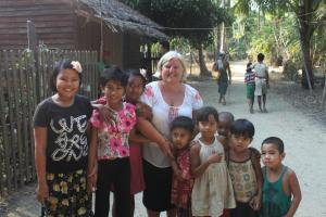 Tracy with children in Myanmar. Photo: supplied