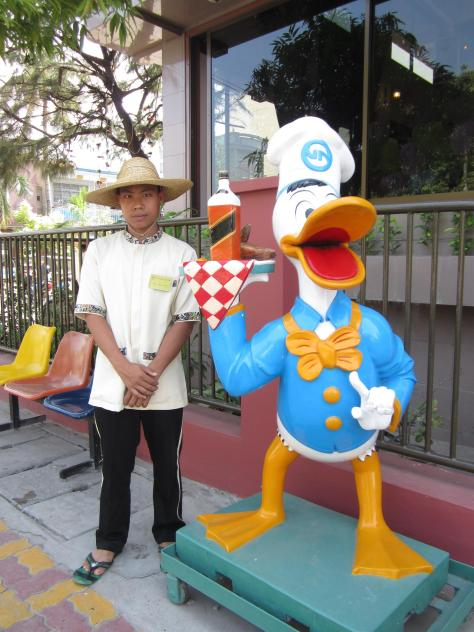 Donald Duck appears to be holding a bottle of Jim Beam out the front of Golden Duck restaurant.