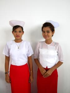 Nurses in supporting roles wait for their cue. Mo Mo Myint Aung is pictured on the right.
