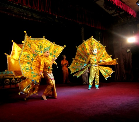 Enjoy a lavish cultural show at Karaweik Palace