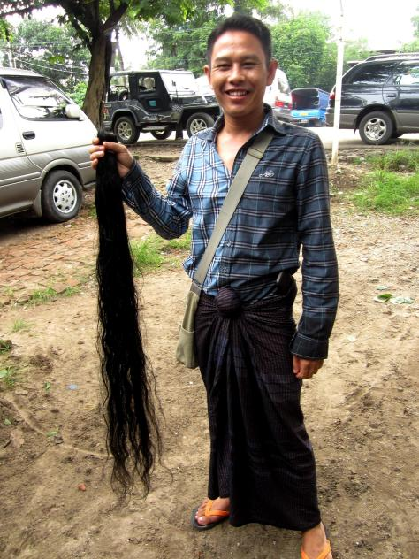 A man attempts to sell this hair to a wholesaler in Thaketa township but is knocked back.