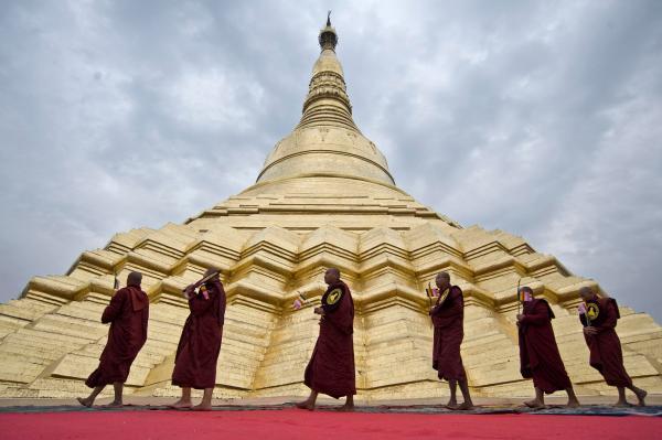 Monks circling the Shwedagon Pagoda. Photo: Kaung Htet