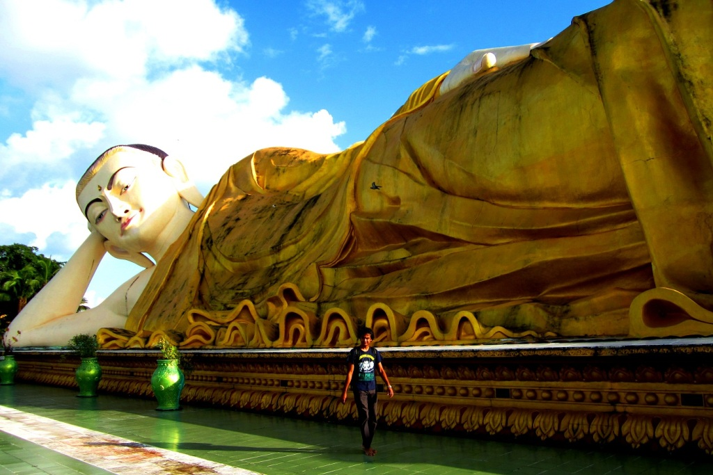 My husband Sherpa takes a long walk around the gigantic reclining Buddha