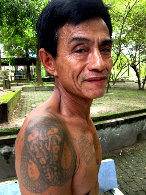 Snake keeper Sein Thein believes his tattoos make him immune to snake venom.