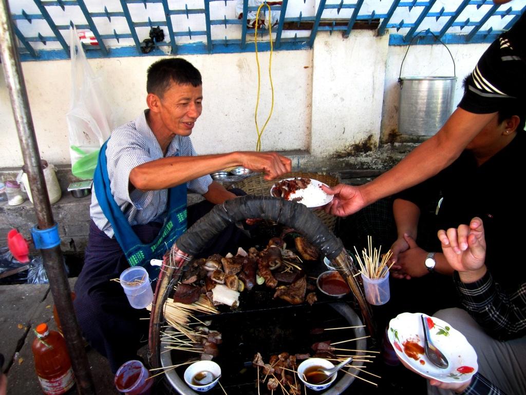 A street food vendor in downtown Yangon