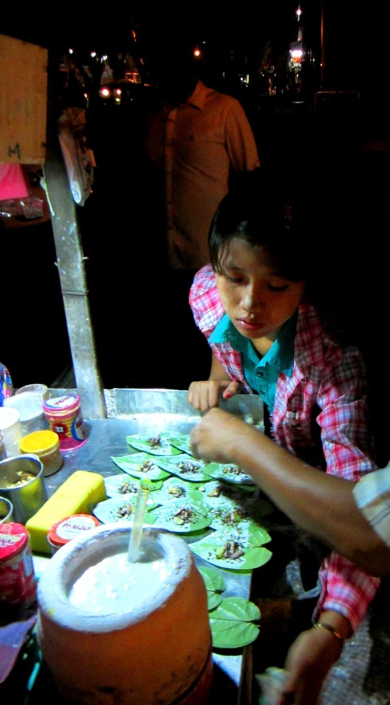 A young girl preparing betel in downtown Yangon
