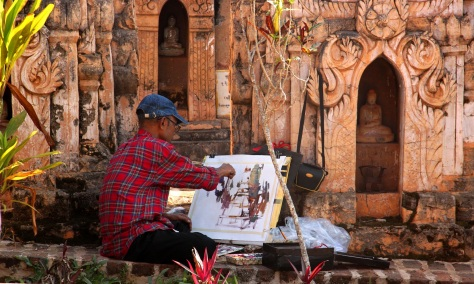 An artist painting Kakku's stupas
