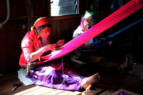 Padaung tribeswomen weaving silk