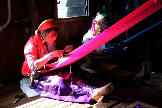 Padaung tribeswomen weaving silk
