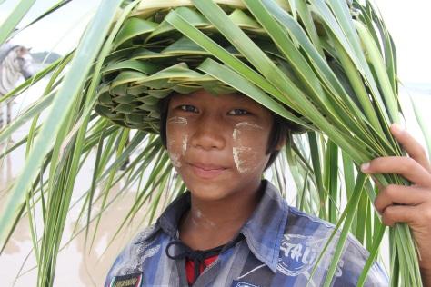 Boy selling palm frond hats on Chaung Tha Beach. Photo: Simon Richmond
