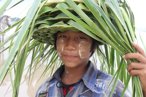 Boy selling palm frond hats on Chaung Tha Beach. Photo: Simon Richmond