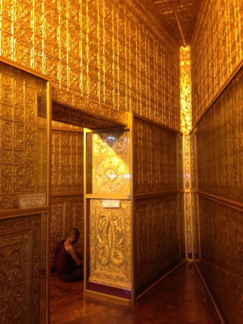 Monk praying inside the Botataung Paya. Photo: Simon Richmond