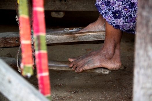 Workers' feet are also used to operate looms, making it a highly labour intensive process.
