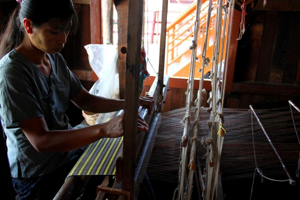 An intricate Burmese loom used to create raw silk and lotus silk textiles.