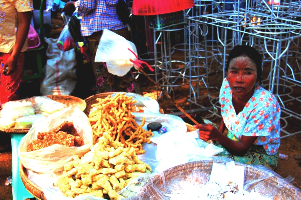 A vendor selling fried snacks