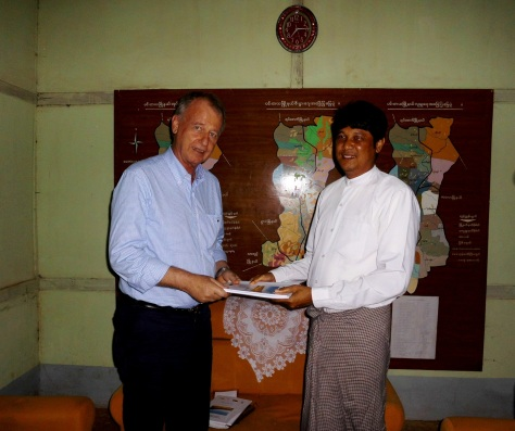 Joern Kristensen hands over the development plan for Danu Self Administered Zone to the township administrator in Pintaya