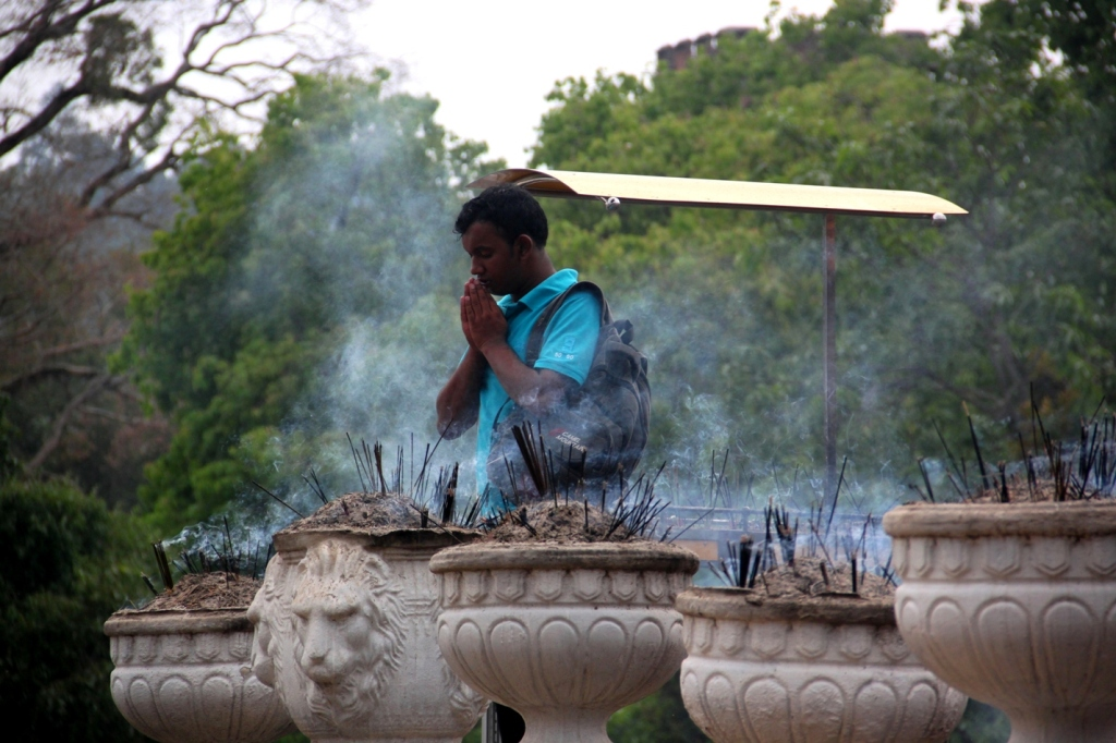 A Buddhist devotee at Kandy's Temple of the Tooth Relic