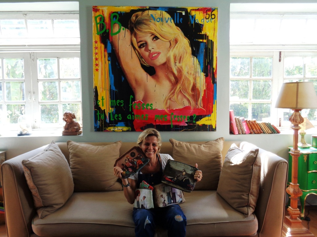 Delphine de Lorme displays Yangoods products at her home in Yangon. The painting above is another of her creations.