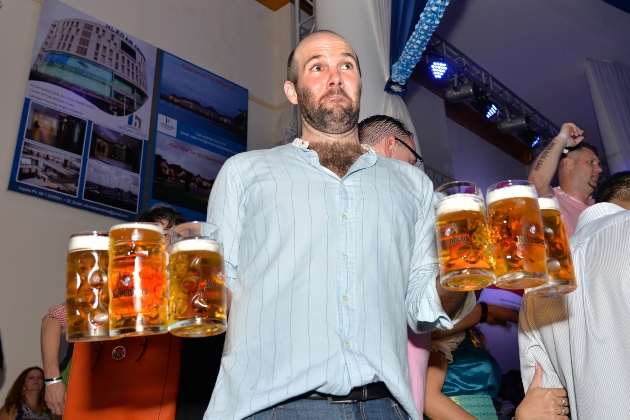 Guests at Oktoberfest enjoyed plentiful mugs of Royal Bavarian beer, which is owned by Prince Luitpold. Photo: Aung Naing Oo