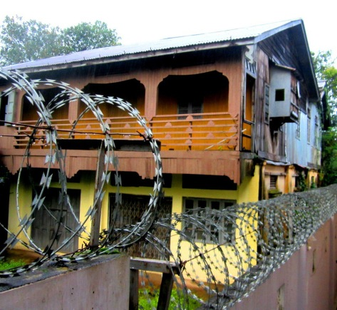 Reams of razor wire are par for the course at most Myanmar homes.