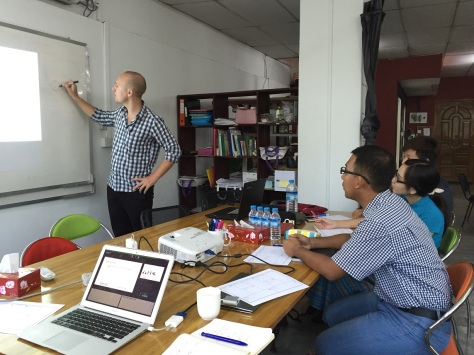 Project Hub Yangon co-founder Pete Silvester mentors a team of MBA students on planning a business start-up. Photo: Richard Edwards