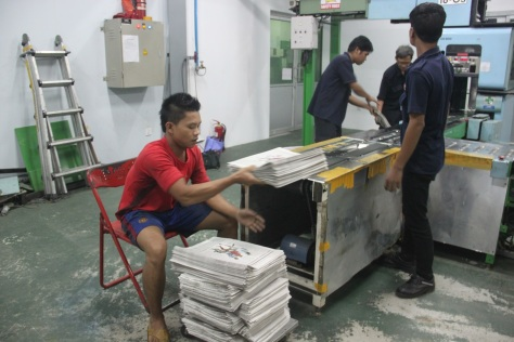 Newspapers come off the press at The Global New Light of Myanmar. Photo: Jessica Mudditt