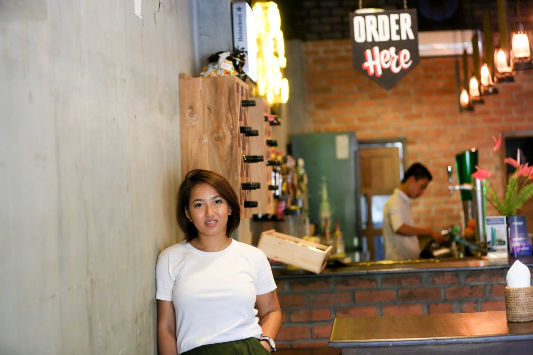 Hnin Yee Htun in her bar. Photo credit: Hong Sar