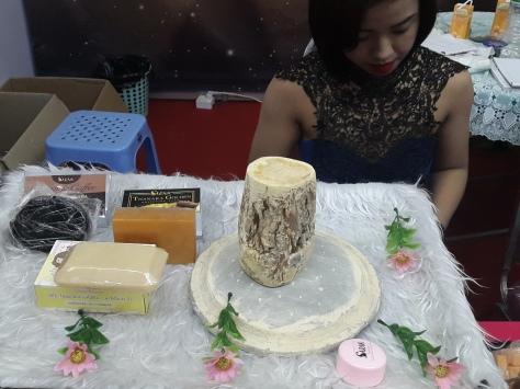 Thanaka on display at a cosmetics fair in Yangon July 2016